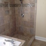 Tile shower with accent strip