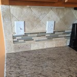 Tile backsplash with mosaic sheet as accent