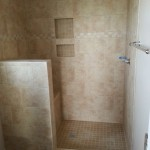 Tiled shower with wall shelf insets