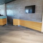 Luxury Vinyl Planks (floor) and Ceramic Tile (wall) installed in a recently constructed commercial building