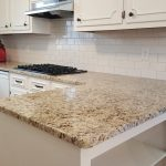 White subway tiles accented with a dark grout to match granite