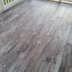Wood-look Porcelain Tile (pre-grout) on screened in porch